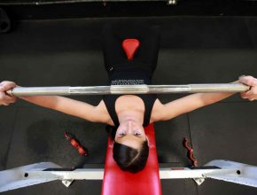 Woman doing a barbell press
