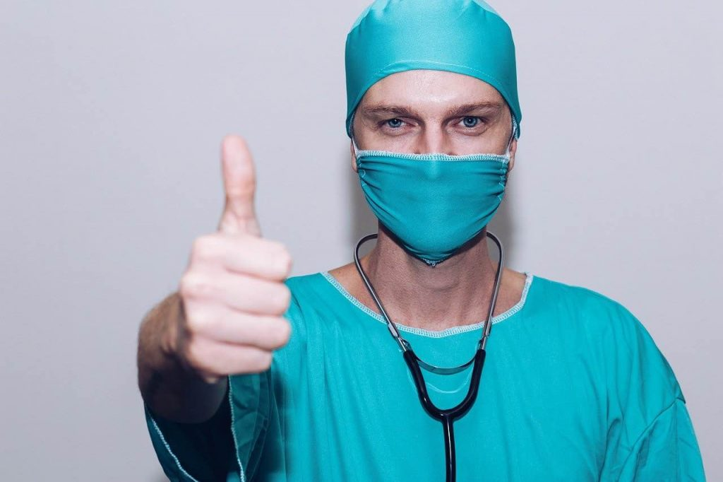 Medical professional giving a thumbs up